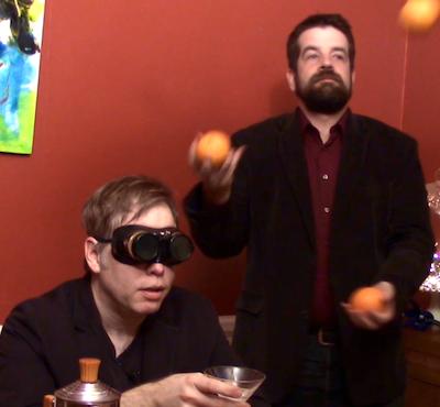 Nicholas Wardigo and David O'Connor with protective eyewear and citrus.