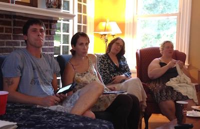 Steve Lythgoe, Annaliese Gove, Ellen Eschenfelder, and Aurora Johansen-Wardigo, all intent on something really important that Sam is saying.