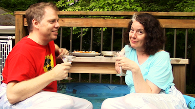 Playwright Nick Wardigo interviews actor Corinna Burns in his kiddie pool.