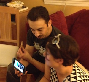 AJ and Tonda, perusing cat photos between acts.