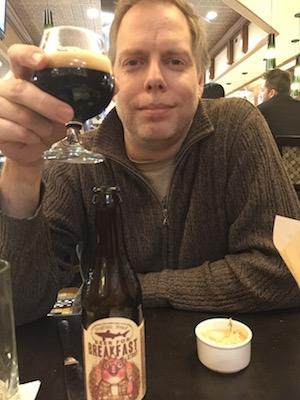 Me, enjoying an after-dinner beer with my wife.
